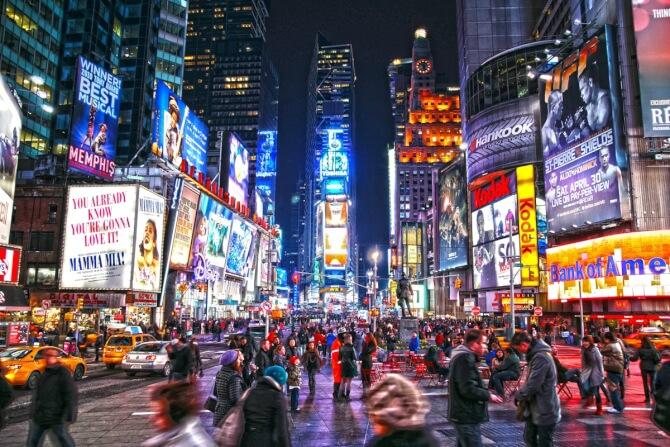 Top 20 things to do in New York: Night view of the Times Square illuminated by billboards