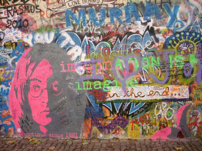 Top 20 things to do in Prague: Part of the Lennon Wall, with the portrait of John Lennon