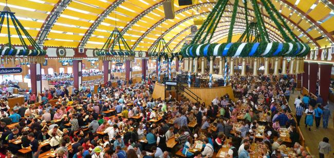Top 20 things to do in Munich: A large hall filled with people drinking beer during Oktoberfest